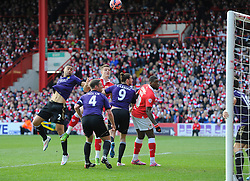 Bristol City's Matt Smith heads towards goal but  West Ham's Mark Noble clears the ball off the line  - Photo mandatory by-line: Joe Meredith/JMP - Mobile: 07966 386802 - 25/01/2015 - SPORT - Football - Bristol - Ashton Gate - Bristol City v West Ham United - FA Cup Fourth Round