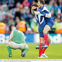 11 February 2007; Lionel Nallet, 4, and Pierre Mignoni, France, celebrate as a dejected Marcus Horan drops to his knees. RBS Six Nations Rugby Championship, Ireland v France, Croke Park, Dublin. Picture Credit: Matt Browne / SPORTSFILE
