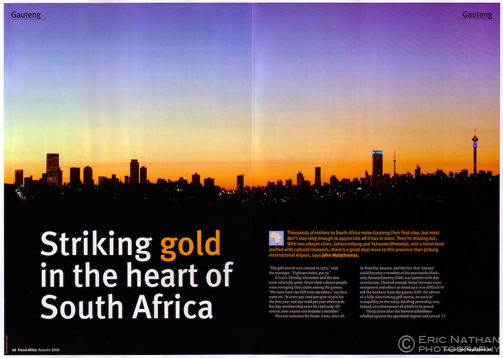 Tear sheet from Travel Africa magazine showing the Johannesburg skyline at dusk.