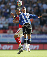 Photo: Lee Earle.<br /> Charlton Athletic v Sheffield Wednesday. Coca Cola Championship. 25/08/2007.Charlton's Madjid Bougherra (L) clashes with Marcus Tudgay.