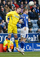 Photo: Steve Bond/Richard Lane Photography. Leicester City v Cardiff City. Coca Cola Championship. 13/03/2010. Paul Gallagher (R) is beaten in the air by Mark Kennedy