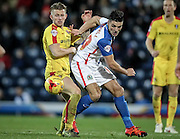 Luke Hyam (Rotherham United) is beaten by Ben Mars (Blackburn Rovers) who turns quickly during the Sky Bet Championship match between Blackburn Rovers and Rotherham United at Ewood Park, Blackburn, England on 11 December 2015. Photo by Mark P Doherty.