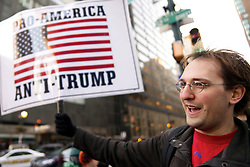 """Seeing the Donald Trump administration do more harm then any President before, David Slottge, of Philadelphia says that is why it is his first time to come out in protest as he stands outside the Loews Hotel in Center City Philadelphia, on January 25, 2017. On Thursday President Donald Trump and UK Prime Minister Theresa May are expected to join republicans gathered for a """"Congress of Tomorrow"""" Joint Republican Issues Conference."""