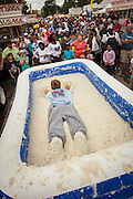 A competitor dives a pool of instant grits during the grits roll competition at the World Grits Festival April 14, 2012 in St. George, SC. The festival celebrates the southern love for the sticky corn porridge