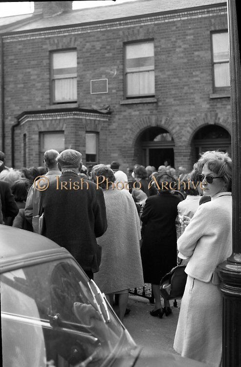 Bloomsday. Plaque unveiled at James Joyce's birthplace, 41 Brighton Square. A lonely figure on the edge of the crowd is Mrs. Beatrice Behan, widow of noted playright Brendan..16.06.1964