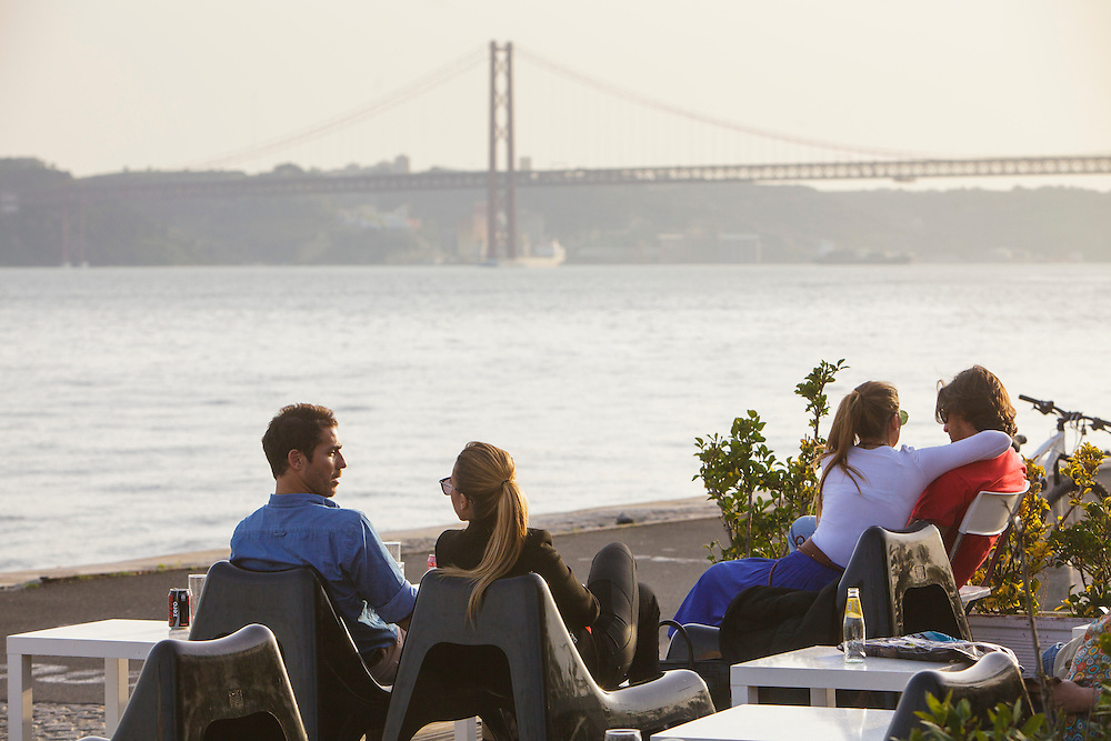 """""""Meninos do Rio"""" bar and esplanade by Tagus riverside in Lisbon."""
