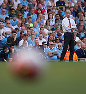 Arsenal manager Arsene Wenger (right) with the ball in the foreground during the Barclays Premier League match at the Etihad Stadium, Manchester<br /> Picture by Russell Hart/Focus Images Ltd 07791 688 420<br /> 08/05/2016