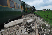 A view of a incident side, where the coaches of railway were derailed and lying on the ground, when anti-talks faction of the National Democratic Front of Bodoland (Ranjan Daimary Group) that is, shortly say - NDFB (R), one of the insurgent group of northeast India, triggered a powerful blast, which flung the locomotive and two numbers of coach of a train (known as - Garib Rath Express) bound for Kolkata (capital of Indian State West Bengal) from Guwahati, the capital of Eastern Indian State, Assam at around 02:28 am, killing a 06-year-old boy (Durlav Sethia) and injuring 23-numbers of  other at Gossaigaon in Kokrajhar district of the Indian State Assam on 08th July, 2010, during Bodo militants, straining at the leash after the arrest of their leader. Pic-Shib Shankar Chatterjee