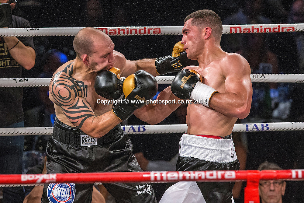 David Aloua (R) fights Anthony McCracken in the Mahindra Super 8 Fight Night, North Shore Events Centre, Auckland, New Zealand, Saturday, November 22, 2014. Photo: David Rowland/Photosport