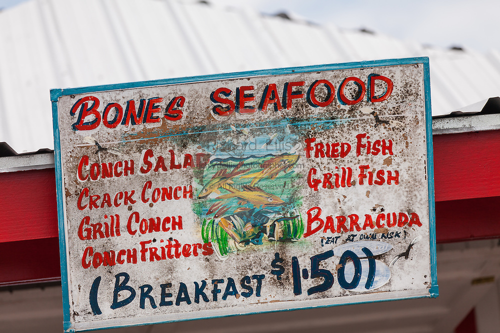 Sign advertising fresh conch at a roadside food stall at Potter's Cay in Nassau, Bahamas.
