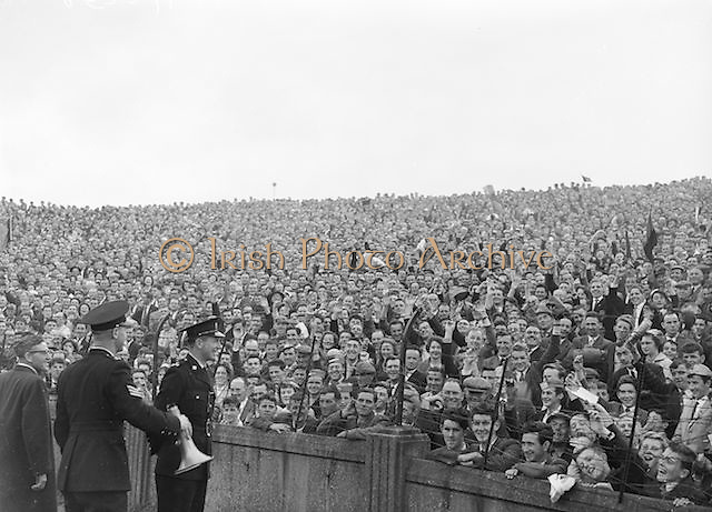 Crowds of supporters watches by the Gardai during the All Ireland Senior Gaelic Football Final Kerry v Down in Croke Park on the 22nd September 1960. Down 2-10 Kerry 0-8.