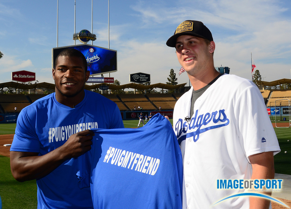 Jun 6, 2016; Los Angeles, CA, USA; Los Angeles Rams quarterback Jared Goff (right) poses with Los Angeles Dodgers right fielder Yasiel Puig before a MLB game against the Colorado Rockies at Dodger Stadium.