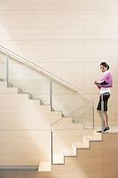 Businesswoman Standing on Stairway