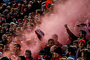 Smoke bomb goes off in the Liverpool fans during the Champions League semi final leg 1 of 2 match between Liverpool and Roma at Anfield, Liverpool, England on 24 April 2018. Picture by Simon Davies.
