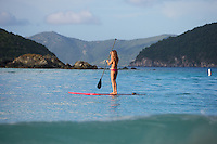 Beautiful paddleboarder on the water of Cinnamon bay beach St. John, USVI.