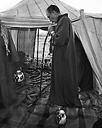 Canadian Prime Minister Pierre Trudeau tries a hooka pipe while camping in the desert near Mada'in Saleh, Saudi Arabia. (1980)