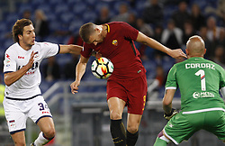October 25, 2017 - Rome, Italy - Roma Edin Dzeko, left, is challenged by Crotone Stefan Simic, left, and goalkeeper Alex Cordaz, during the Serie A soccer match between Roma and Crotone at the Olympic stadium. (Credit Image: © Riccardo De Luca/Pacific Press via ZUMA Wire)