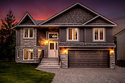 Twilight image of a property listing
