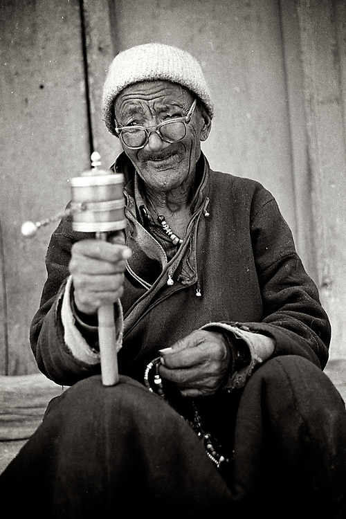 Leh, Ladakh. A Tibetan man praying. <br />