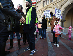 "December 10, 2016 - Washington, DC, USA - Security talks with organizers about march around Trump hotel. Children's Rally for Kindness takes place at Trump International Hotel in Washington DC on December 10, 2016 organized by the Takoma Parents Action Coalition.  According to their FaceBook page, it was a call to President-elect Donald Trump: ''to remember these lessons as he prepares to take office and implement policies that will affect the lives of children and families across our diverse nation.''.''All over the world, across cultures and countries, children learn the same basic lessons: .Ã'be kind,Ã"" .Ã'tell the truth,Ã"" .Ã'be fair,Ã"" .Ã'respect everyone,Ã"" .Ã'treat others the way you want to be treated,Ã"" .Ã'donÃ•t touch others if they donÃ•t want to be touched. (Credit Image: © Carol Guzy via ZUMA Wire)"