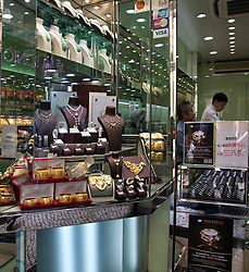 Capitalism and consumerism is the order of the day in China's major cities (3/2017), witness this jewelry store display in downtown Macau. Note the credit card decals at the top. Luxury goods from around the world are widely available.