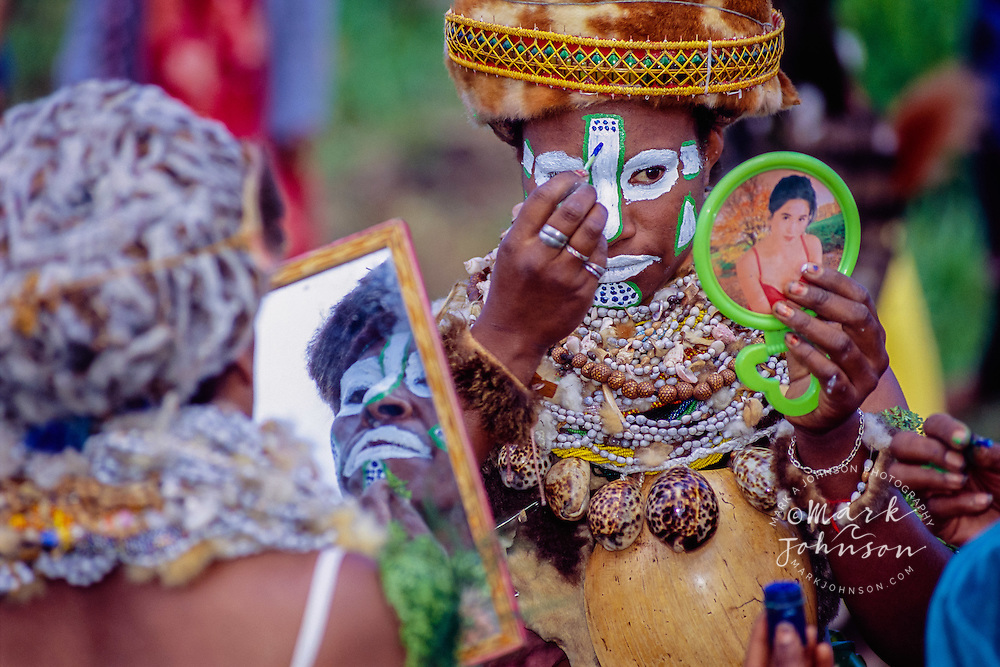 Mount Hagen, Papua New Guinea --- Performers wearing traditional costumes apply face paint for the Mount Hagen Cultural Show.