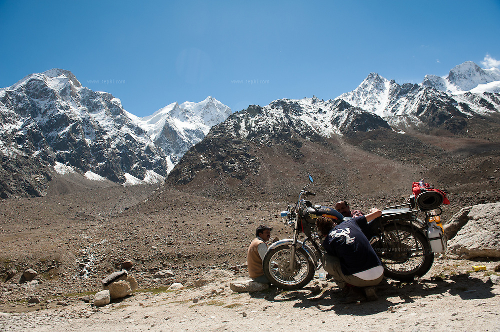 Scene from a group of motorcycle riders riding Royal Enfield bikes on a tour from Manali to Spiti in HImachal Pradesh
