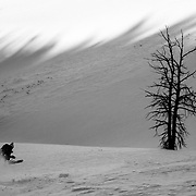 Kim Havell skis wind buffed powder in the backcountry off of Teton Pass near Wilson, Wyoming.