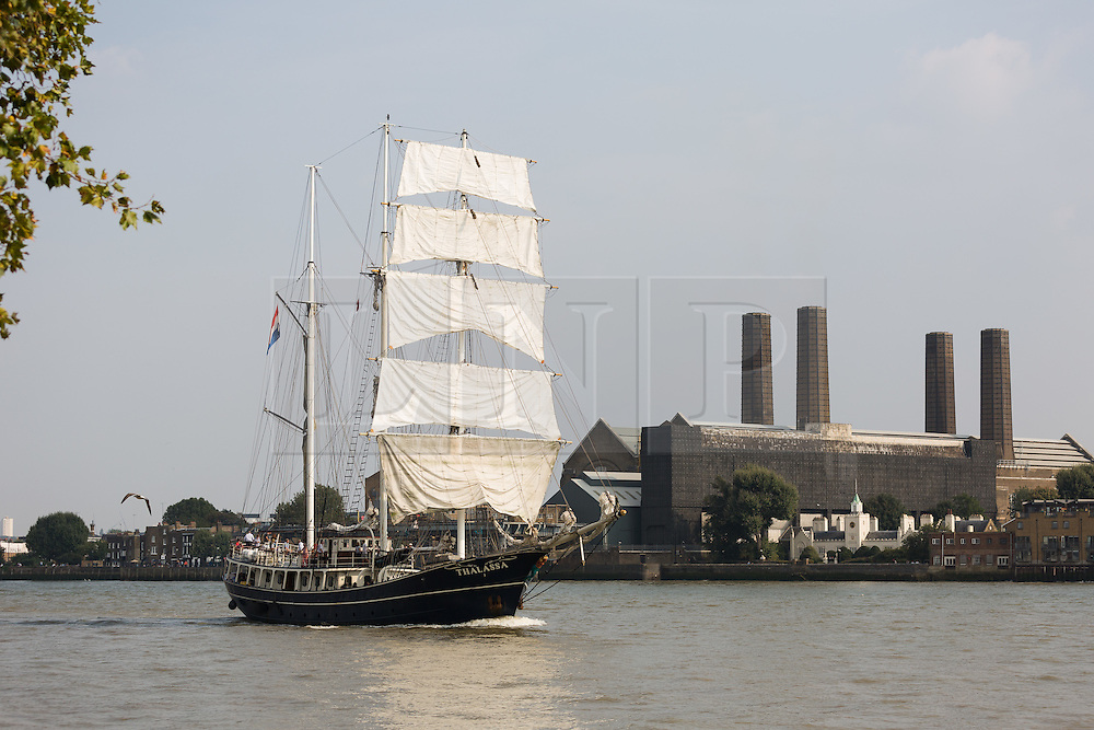 © Licensed to London News Pictures. 15/06/2016. LONDON, UK.  The historic tall ship,  Thalassa is seen passing the Greenwich Power Station on the River Thames in Greenwich. The Sail Royal Greenwich Tall Ship Festival runs until this Sunday, 18th Septmeber.  Photo credit: Vickie Flores/LNP