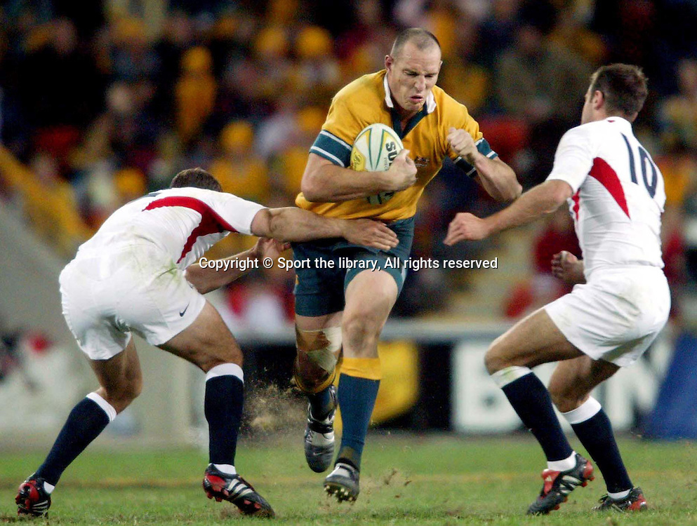Stirling Mortlock braces for tackle.<br />