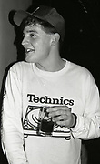 808 state member, Darren, having a drink at his band's gig, Piccadilly venue, Manchester, 1989.