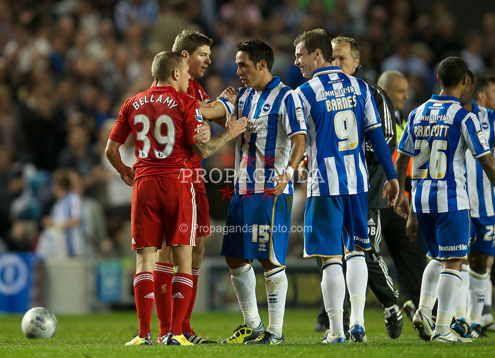 BRIGHTON, ENGLAND - Wednesday, September 21, 2011: Liverpool's Craig Bellamy is pulled away by captain Steven Gerrard MBE as he clashes with Brighton & Hove Albion's Ashley Barnes during the Football League Cup 3rd Round match at the Amex Stadium. (Pic by David Rawcliffe/Propaganda)