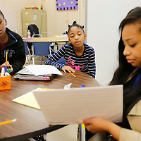 THOMAS WELLS | BUY at PHOTOS.DJOURNAL.COM<br /> Joyner Elementary School students Jaihlyce Moore, left, and Makhia Bogan work with Kelly Orr on their literacy skills as part of a school wide program to help student move onto the fourth grade.