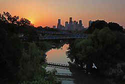 Buffalo Bayou and silhouetted Houston Skyline At Sunset.