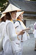 Pilgrims praying in front of the temple Hotsumisaki-ji (最御崎寺) in Muroto,Kōchi Prefectur, Japan<br /> The Shikoku Pilgrimage, 88 temples associated with the Buddhist monk Kukai (Kobo Daishi) on the island of Shikoku in Japan.