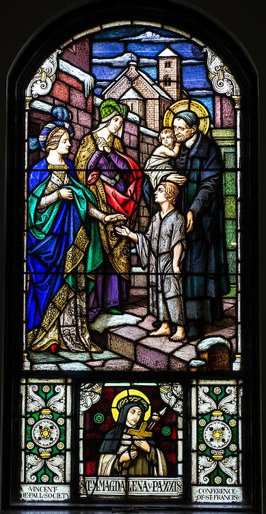 Stained glass image depicts St. Vincent de Paul. (Sam Lucero photo)