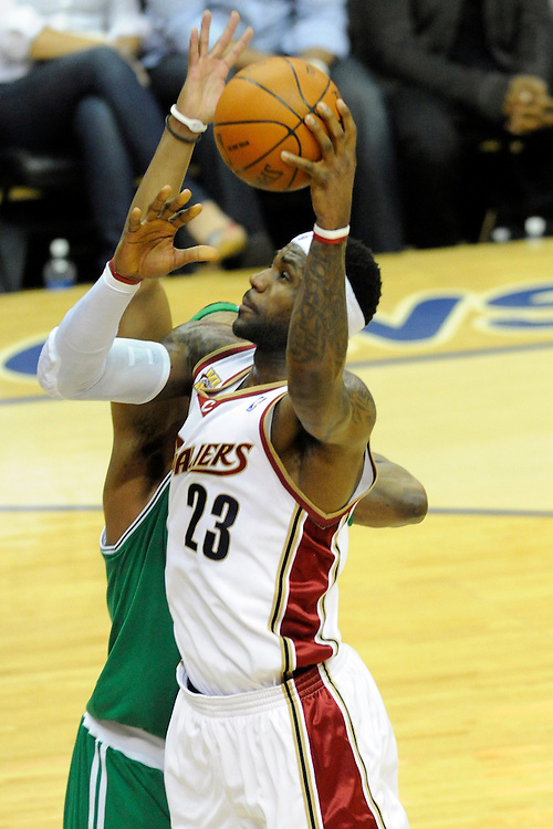 May 1, 2010; Cleveland, OH, USA; LeBron James (23) shoots over Boston Celtics forward Paul Pierce (34) during the first quarter of game one in the eastern conference semifinals in the 2010 NBA playoffs at Quicken Loans Arena. Mandatory Credit: Jason Miller-US PRESSWIRE