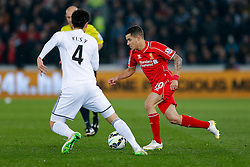 Philippe Coutinho of Liverpool is challenged by Ki Sung-Yueng of Swansea City - Photo mandatory by-line: Rogan Thomson/JMP - 07966 386802 - 16/03/2015 - SPORT - FOOTBALL - Swansea, Wales — Liberty Stadium - Swansea City v Liverpool - Barclays Premier League.