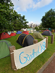 Climate change protesters have set up camp outside the Scottish Parliament to highlight the growing dangers of climate change. Organisers plan several days of direct action along with marches and workshops. A heavier than usual police presence was in evidence around the site.<br /> <br /> © Dave Johnston / EEm