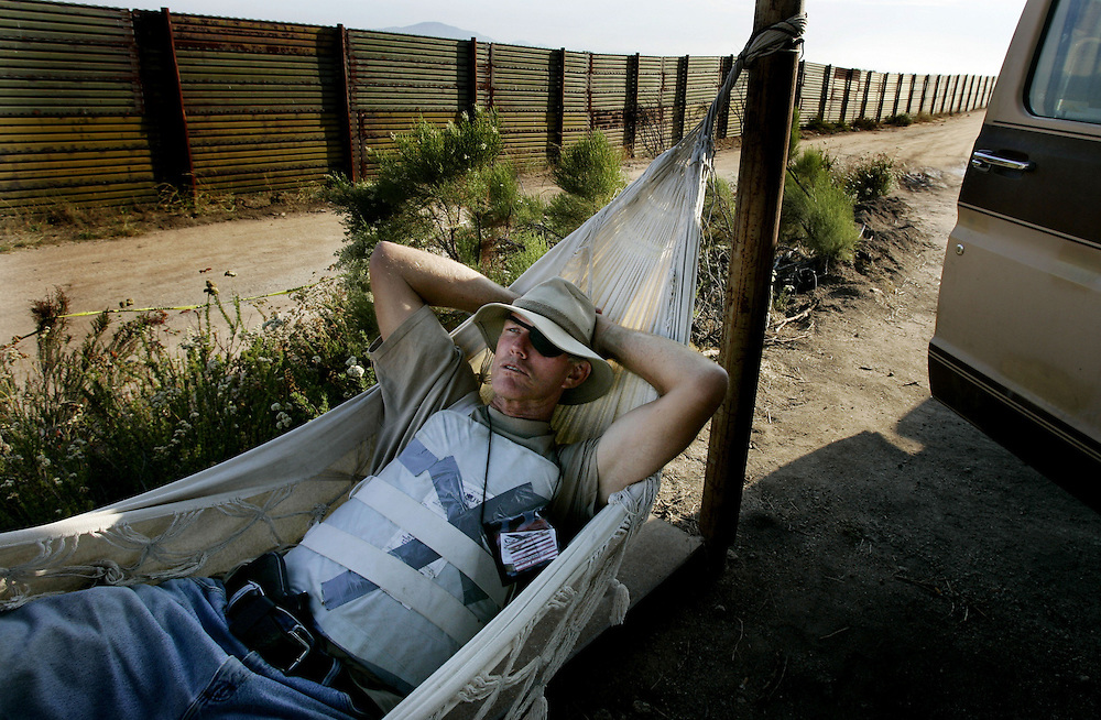 California Minuteman volunteer Britt Craig rests in his hammock before going on patrol along the U.S./Mexico Border in Campo, Calif. on Thursday, August 4, 2005.  The controversial border-watch group has been staked out along parts of the California Border since July 16th in an attempt to stem the flow of illegal immigration and possible terrorist suspects trying to get into the United States.