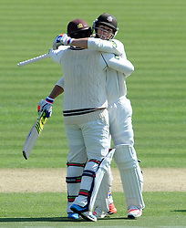 Surrey's Steven Davies celebrates his double century with Tom Curran. - Photo mandatory by-line: Harry Trump/JMP - Mobile: 07966 386802 - 20/04/15 - SPORT - CRICKET - LVCC County Championship - Division 2 - Day 2 - Glamorgan v Surrey - Swalec Stadium, Cardiff, Wales.