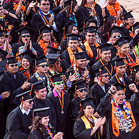 051713       Cable Hoover<br /> <br /> Gallup High School class of 2013 graduates clap and cheer during their graduation ceremony Friday at Red Rock Park in Gallup.