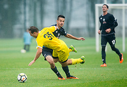 Mike Urbanija of Fantazisti faulting Lukas Weinhandl of 1st TFC during friendly football match between NK Fantazisti (SLO) and 1st TFC - First Tennis & Football Club (AUT) presented by professional and former tennis players, on November 25, 2017 in Nacionalni nogometni center Brdo pri Kranju, Slovenia. Photo by Vid Ponikvar / Sportida