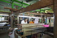 Young women working in a textiles factory in Mandalay, Myanmar.