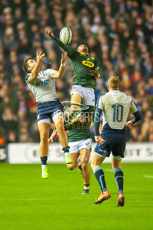 Sbu Nkosi (#14) (Cell C Sharks) of South Africa and Sean Maitland (#11) (Saracens) of Scotland jump for the ball during the Autumn Test match between Scotland and South Africa at the BT Murrayfield Stadium, Edinburgh, Scotland on 17 November 2018.