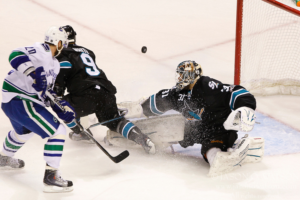 May 22, 2011; San Jose, CA, USA;  San Jose Sharks goalie Antti Niemi (31) saves a shot from Vancouver Canucks left wing Christopher Higgins (20) during the first period of game four of the western conference finals of the 2011 Stanley Cup playoffs at HP Pavilion.  Vancouver defeated San Jose 4-2. Mandatory Credit: Jason O. Watson / US PRESSWIRE