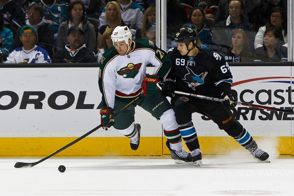 Nov 10, 2011; San Jose, CA, USA; Minnesota Wild center Kyle Brodziak (21) is defended by San Jose Sharks center Andrew Desjardins (69) during the first period at HP Pavilion.  San Jose defeated Minnesota 3-1. Mandatory Credit: Jason O. Watson-US PRESSWIRE