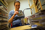 KDIC Director Kelly Marie Musselman sorts through CDs in the music library on the second floor of the JRC on Tuesday.