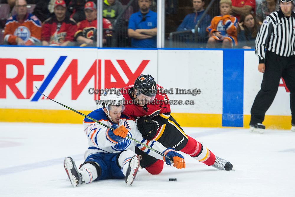 PENTICTON, CANADA - SEPTEMBER 17: Matthew Tkachuk #19 of Calgary Flames checks Greg Chase #72 of Edmonton Oilers on September 17, 2016 at the South Okanagan Event Centre in Penticton, British Columbia, Canada.  (Photo by Marissa Baecker/Shoot the Breeze)  *** Local Caption *** Greg Chase; Matthew Tkachuk;