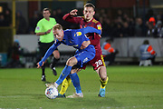 AFC Wimbledon midfielder Mitchell (Mitch) Pinnock (11) battles for possession with Ipswich Town defender Luke Woolfenden (28) during the EFL Sky Bet League 1 match between AFC Wimbledon and Ipswich Town at the Cherry Red Records Stadium, Kingston, England on 11 February 2020.